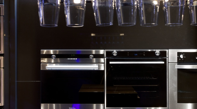 While the show space is modest the appliance glass, interior design, kitchen, light, light fixture, lighting, purple, black