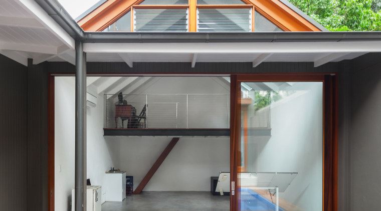This new artists studio with a mezzanine has daylighting, deck, house, outdoor structure, real estate, roof, gray, white