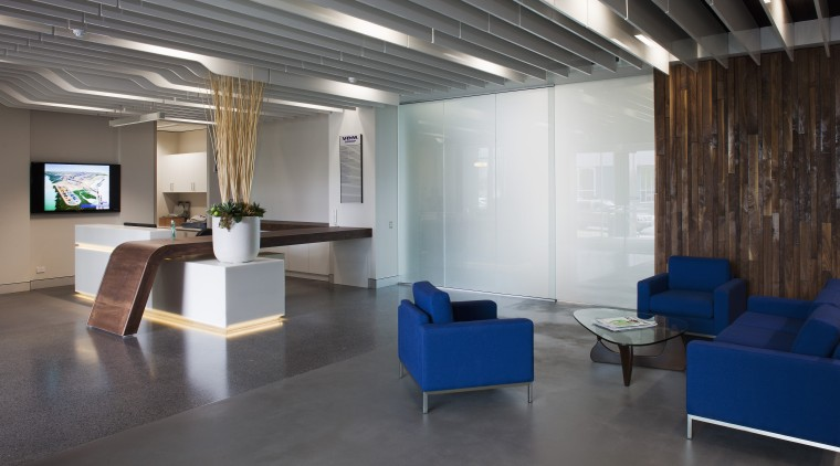 This boutique office development on a brownfields site architecture, ceiling, floor, flooring, furniture, interior design, lobby, office, real estate, table, gray