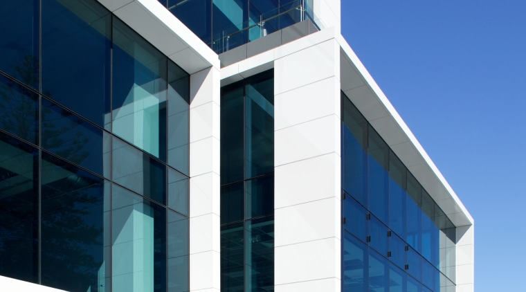 Watercare House in Newmarket boasts a strong street architecture, building, commercial building, corporate headquarters, daytime, elevation, facade, headquarters, metropolitan area, mixed use, sky, structure, blue