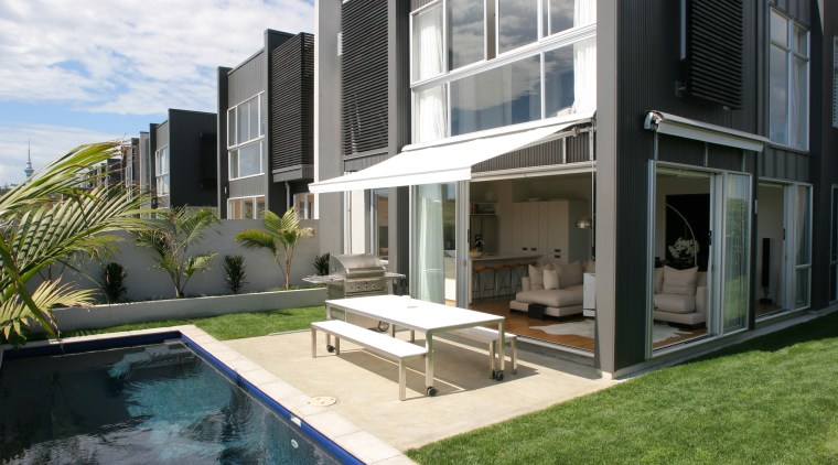 A modern townhouse custom built and designed by apartment, architecture, condominium, elevation, estate, home, house, property, real estate, residential area, swimming pool, villa, window, black