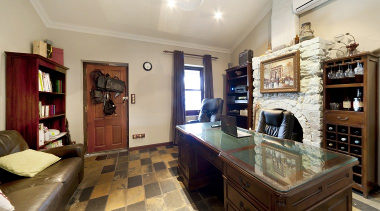 This renovated cottage has become a home office. countertop, estate, home, interior design, kitchen, property, real estate, room, gray, brown