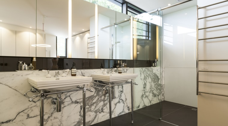 A marble-lined bathroom with steel-framed basins is a architecture, countertop, floor, flooring, interior design, product design, room, gray