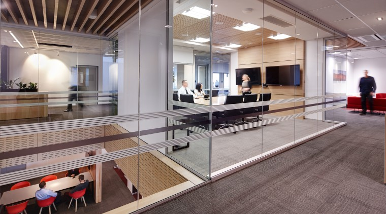 The large stairway void, centrally located hubs and floor, flooring, interior design, lobby, wood, gray