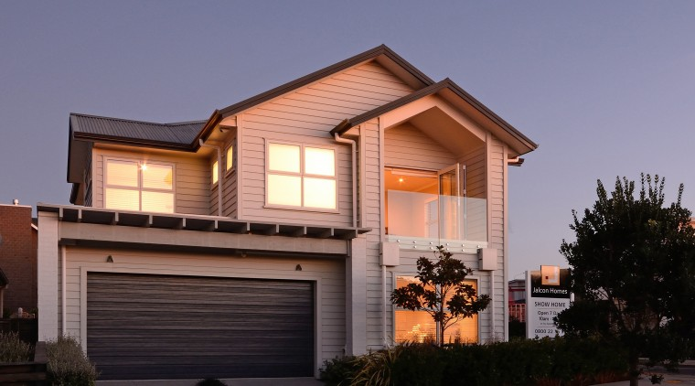 The Landing, a two-storey, weatherboard show home was building, elevation, facade, home, house, property, real estate, residential area, roof, siding, window, black, blue