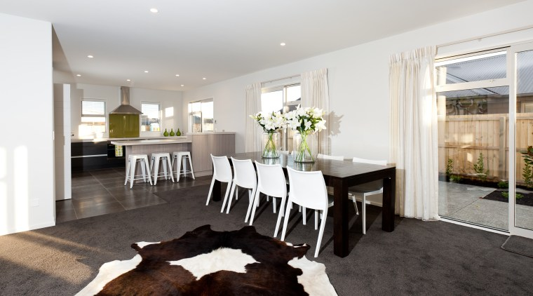 This new steel-framed show home in Hamill Rd, dining room, floor, flooring, home, house, interior design, living room, property, real estate, room, table, white