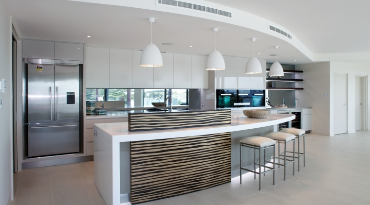 High above the street, this penthouse apartment opens countertop, interior design, kitchen, product design, real estate, gray
