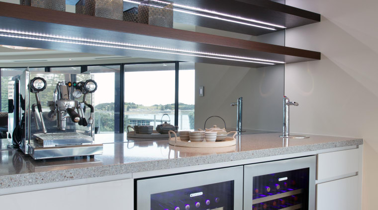The view is reflected in the mirrored glass interior design, kitchen, gray