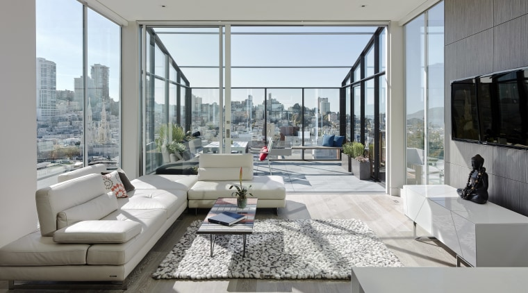 Floor-to-ceiling glass walls encircle one end of the apartment, architecture, condominium, house, interior design, living room, penthouse apartment, property, real estate, window, gray