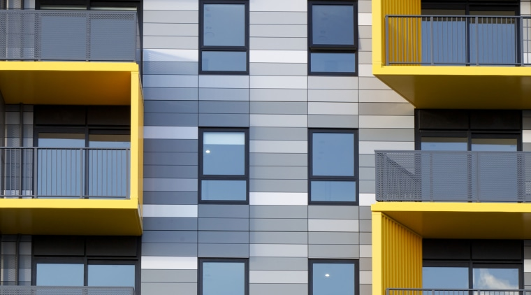 A close-up view of the colourful Alucobond cladding apartment, architecture, building, commercial building, condominium, daytime, elevation, facade, house, line, mixed use, residential area, symmetry, window, yellow, gray