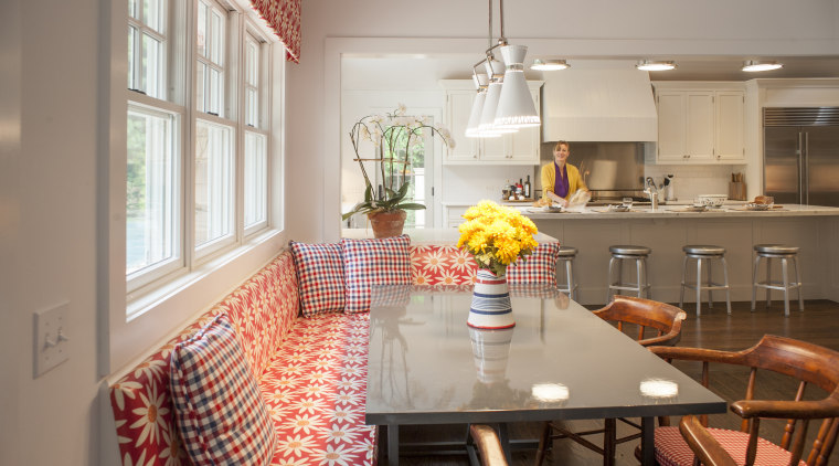 Colorful banquette seating is a feature of the chair, countertop, dining room, furniture, home, interior design, kitchen, living room, real estate, room, table, gray, brown