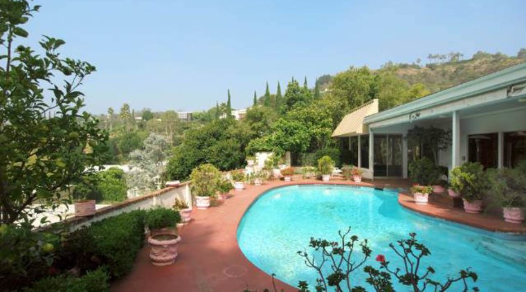 A kidney-shaped pool and terracotta paving were typical estate, hacienda, home, house, leisure, property, real estate, resort, resort town, swimming pool, villa, teal