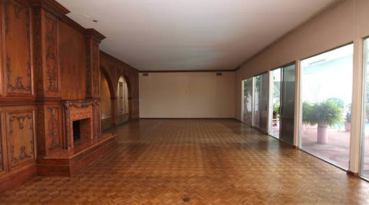 Wood panelling and a parquet floor were features ceiling, estate, floor, flooring, hardwood, home, house, laminate flooring, property, real estate, room, wood, wood flooring, wood stain, brown, gray