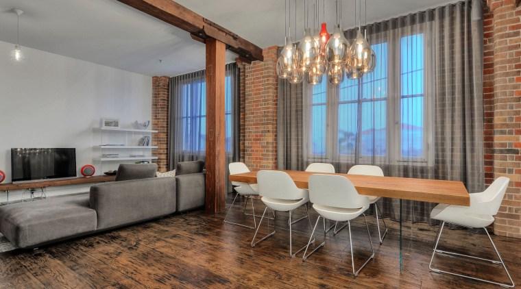 Original timber support beams, exposed brick walls and ceiling, floor, flooring, hardwood, interior design, living room, loft, real estate, room, table, wood flooring, gray, brown