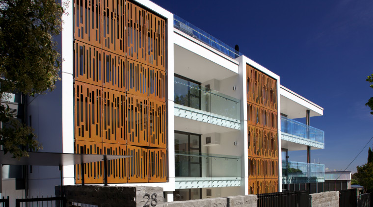 Powdercoated aluminium screens that resemble Corten steel feature apartment, architecture, building, commercial building, condominium, corporate headquarters, elevation, facade, home, house, mixed use, neighbourhood, property, real estate, residential area, window, blue, black