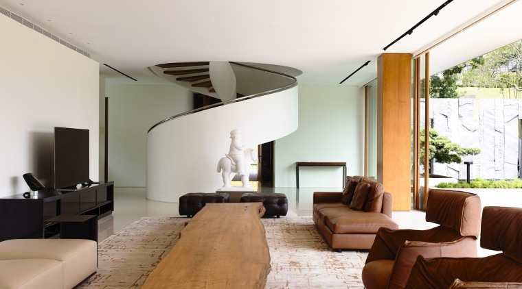 This entry to a room on the lower architecture, ceiling, house, interior design, living room, real estate, room, table, white