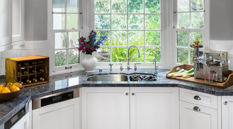 A bay window at one end of this cabinetry, countertop, cuisine classique, interior design, kitchen, room, window, gray