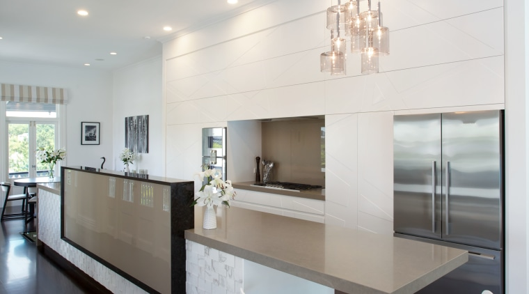 A rectangular privacy element on this island hides architecture, ceiling, countertop, home, house, interior design, kitchen, light fixture, product design, table, gray