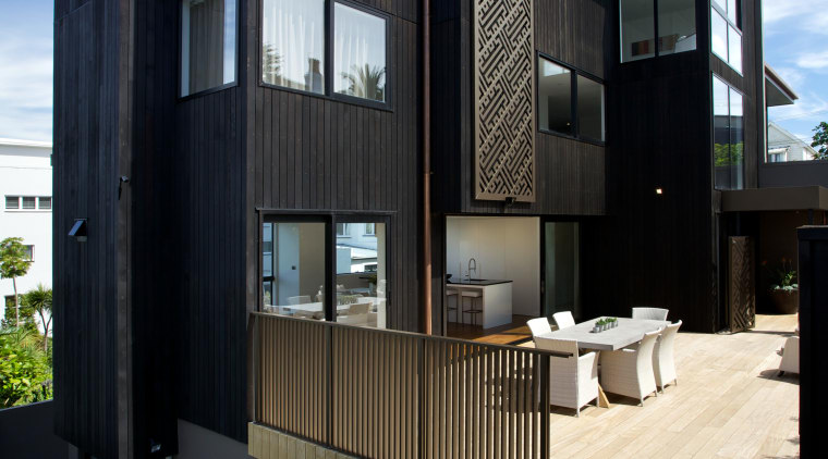 The monolithic shape of this townhouse building was apartment, architecture, building, condominium, elevation, facade, home, house, real estate, residential area, black