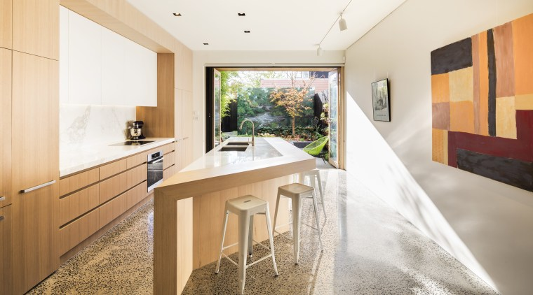 Cooking meets curating in this design with the architecture, house, interior design, real estate, white, orange
