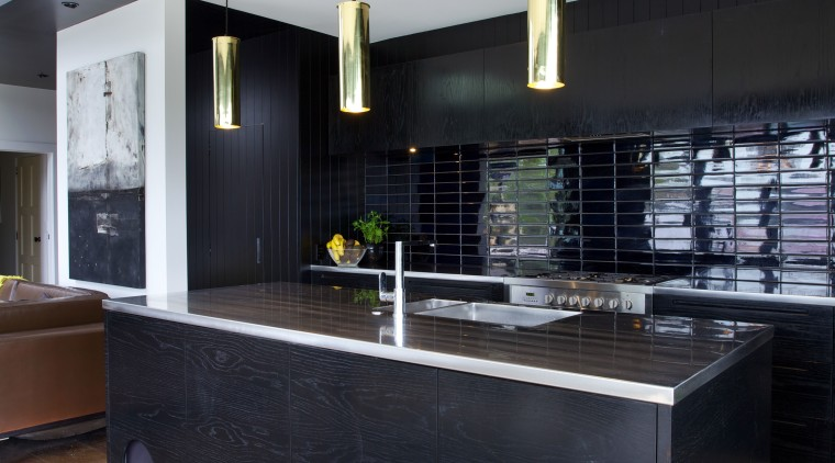 In this black kitchen there are three brass architecture, countertop, interior design, kitchen, black, white