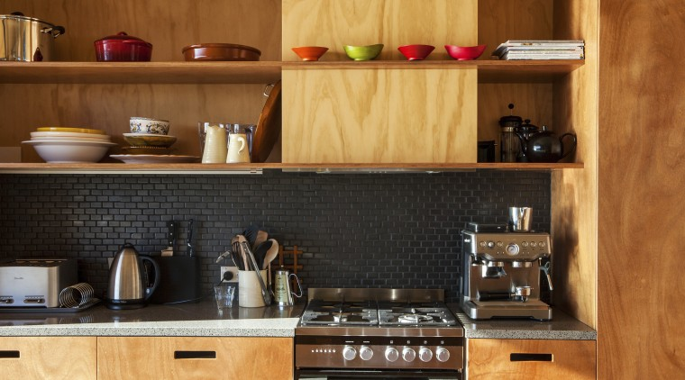Gaboon shelving in this new holiday home contrasts cabinetry, countertop, cuisine classique, interior design, kitchen, kitchen organizer, wood, brown, orange