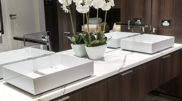 Contemporary thin-walled rectangular basins provide a crisp counterpoint coffee table, countertop, furniture, interior design, product design, sink, table, tap, black, white