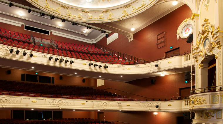 Custom chandeliers at the Isaac Theatre Royal were auditorium, ceiling, concert hall, opera house, performing arts center, theatre, orange, brown, red