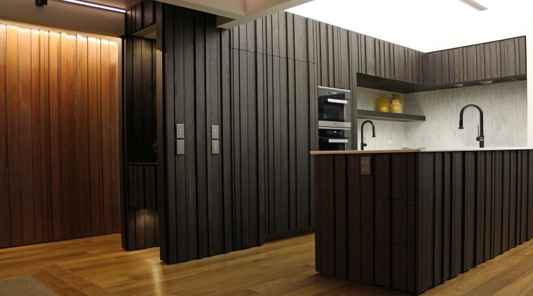 Dark-stained American oak cabinets with a custom profile floor, flooring, interior design, lobby, wood, black, brown