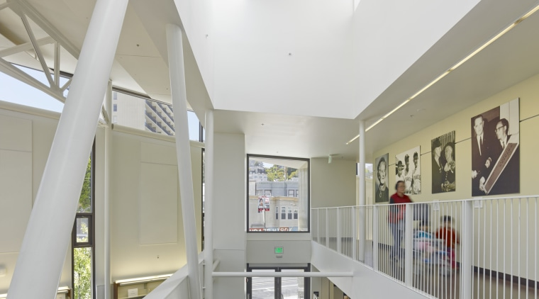 Exposed structural elements and services help to keep architecture, building, ceiling, daylighting, handrail, institution, interior design, lobby, white, gray