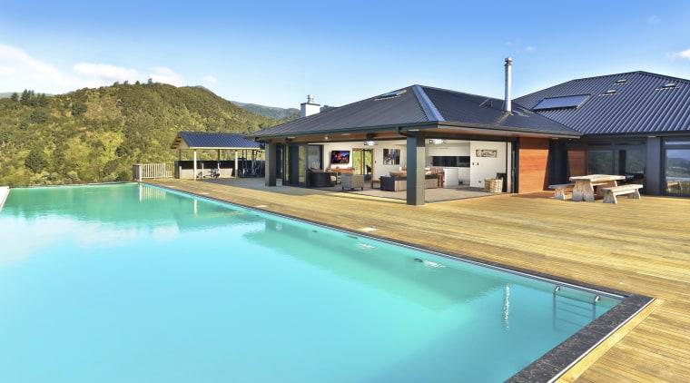 A large alfresco living area provides shelter for estate, home, house, leisure, property, real estate, resort, sky, swimming pool, villa, teal