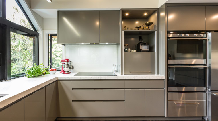 This contemporary kitchen by Kitchens By Design incorporates cabinetry, countertop, cuisine classique, home appliance, interior design, kitchen, room, white