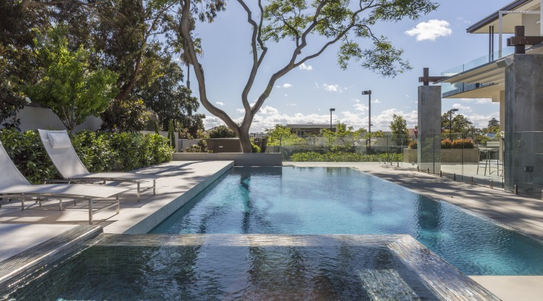 This new poolscape features a swimming pool with estate, home, house, leisure, property, real estate, reflection, resort, swimming pool, tree, villa, water, teal