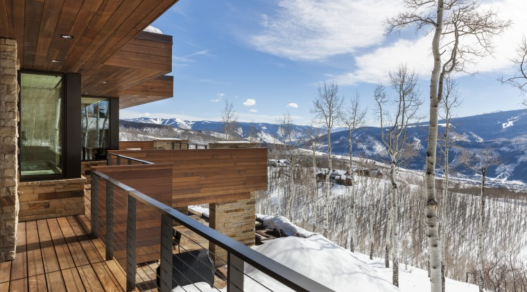 There is an intimate feel to this mountain apartment, architecture, cottage, home, house, log cabin, mountain, property, real estate, roof, siding, sky, snow, tree, winter, wood, white, brown