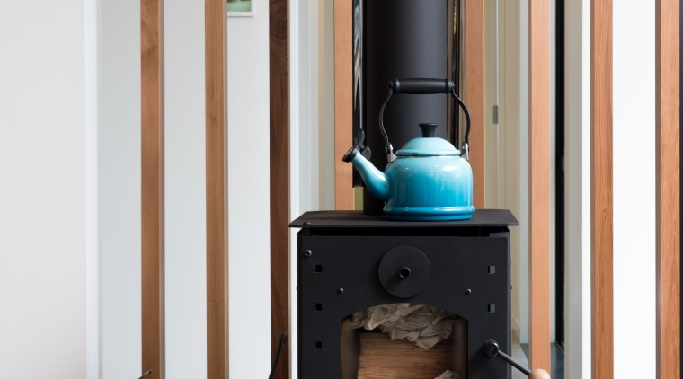Colour pops add personality to the serene palette hearth, home appliance, wood burning stove, gray