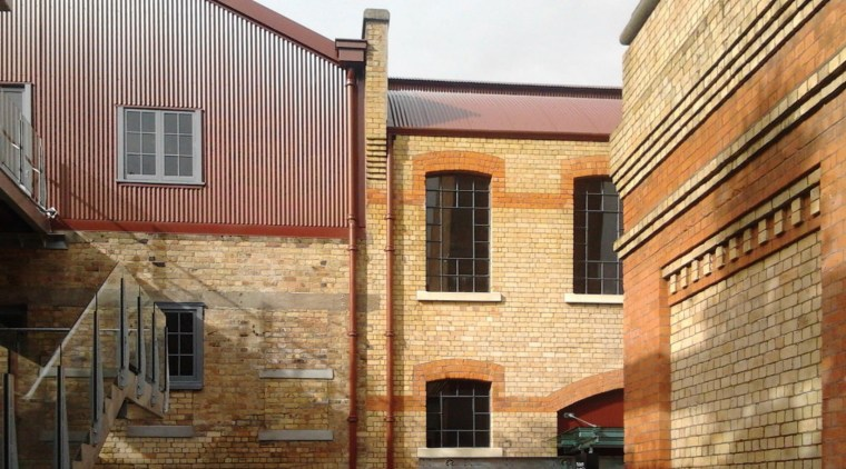 Historic buildings have a value to the community apartment, architecture, brick, brickwork, building, facade, home, house, neighbourhood, property, real estate, residential area, roof, siding, wall, window, brown