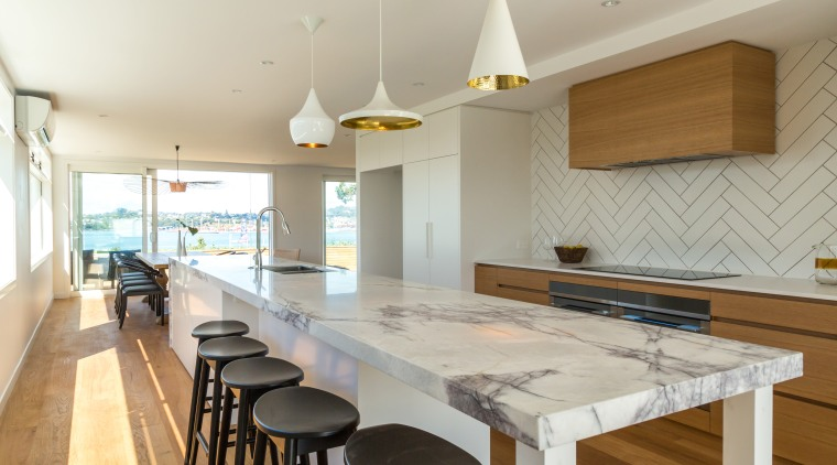 Dramatic kitchen island in Devonport renovation with patterned countertop, interior design, kitchen, property, real estate, table, gray