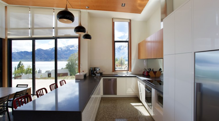 Large sliding doors open up the entire family architecture, ceiling, countertop, interior design, kitchen, real estate, gray