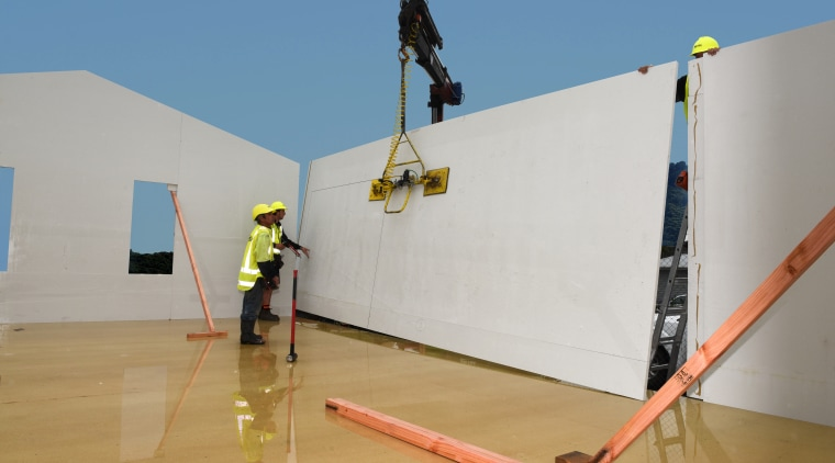 Prefabrication technology is speeding up the build time roof, wall, gray, teal