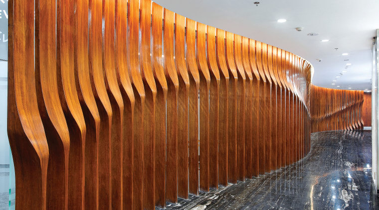 Full-height wood fins screen the managing directors office architecture, wall, wood, brown