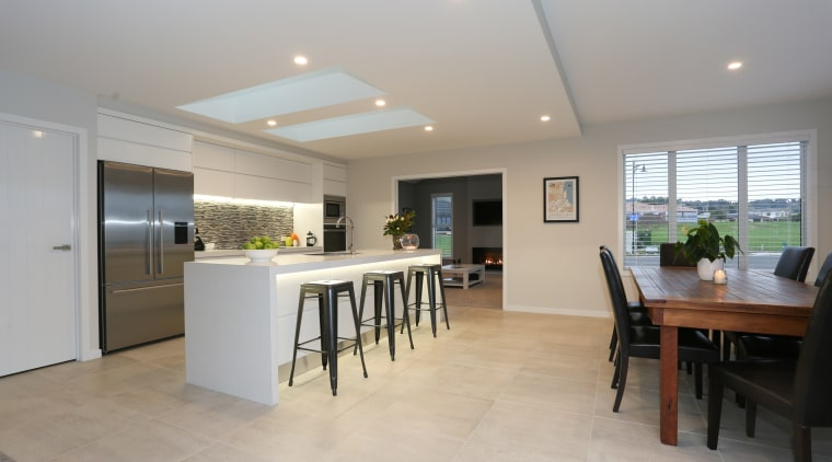 LED downlights enliven the front of the island daylighting, floor, flooring, house, interior design, kitchen, property, real estate, gray