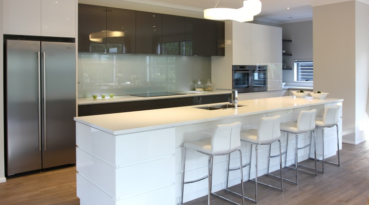 The acrylic layer of this cabinetry gives the cabinetry, countertop, cuisine classique, interior design, kitchen, real estate, gray