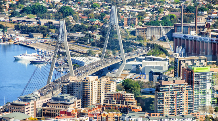 Sydneys ANZAC Bridge is one of the more aerial photography, bird's eye view, bridge, city, cityscape, daytime, downtown, fixed link, landmark, metropolis, metropolitan area, port, sky, skyline, skyscraper, suburb, tower block, urban area, urban design, water, waterway