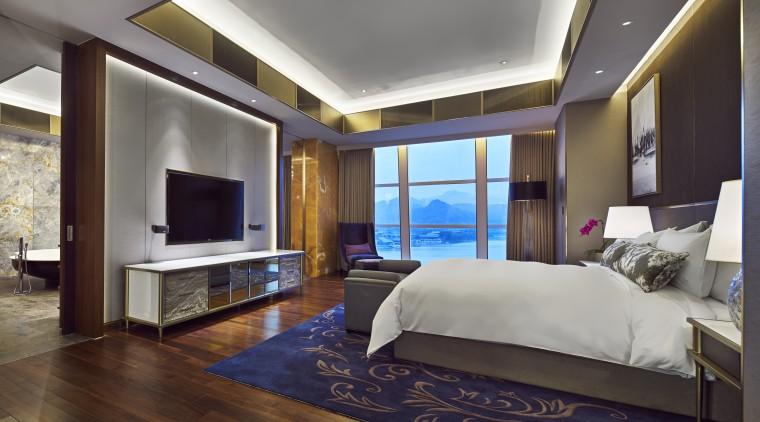 Tthe Sunrise Hotel Kempinski, Beijng, evokes the sun bedroom, ceiling, estate, floor, interior design, living room, property, real estate, room, suite, wall, wood flooring, gray