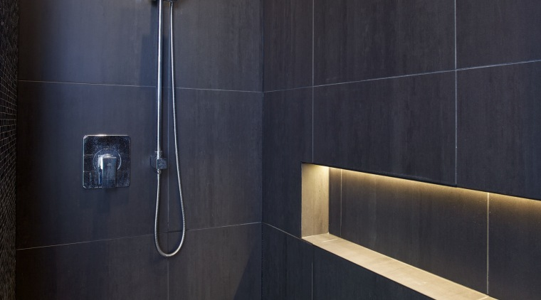 LED lights tucked behind the vanity mirror and architecture, bathroom, floor, interior design, light, lighting, plumbing fixture, room, shower, tile, wall, black