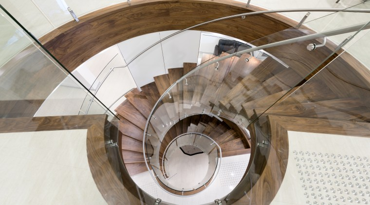 This dramatic staircase features tightly curved glass panels product design, stairs, table, white, brown