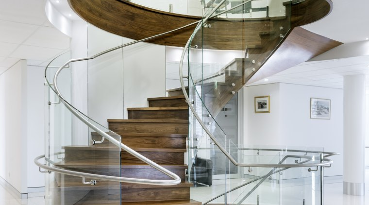 Tight curves in the glass balustrade help make furniture, glass, interior design, product design, stairs, table, gray, white