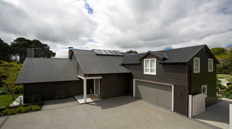 Popular on all styles of homes, Colorsteel is architecture, cottage, facade, home, house, property, real estate, residential area, roof, siding, suburb, gray, white
