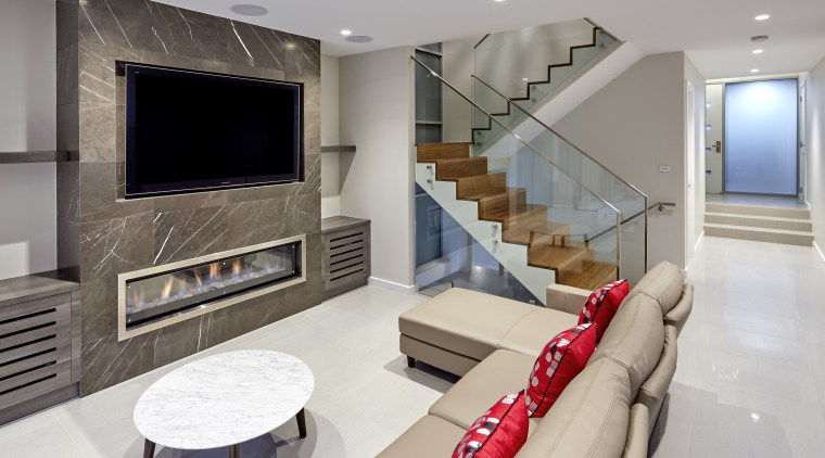 A stone fire surround and wood and glass ceiling, floor, home, interior design, living room, real estate, room, gray