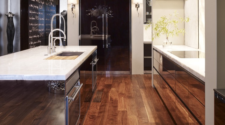 Polished stainless on the island and high gloss cabinetry, countertop, cuisine classique, floor, flooring, hardwood, interior design, kitchen, laminate flooring, tile, wood, wood flooring, brown, gray